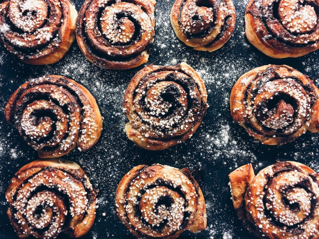 cinnamon buns dusted with icing sugar